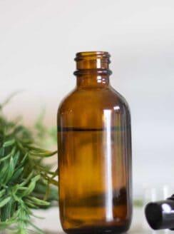 homemade bug repellent in glass bottle.