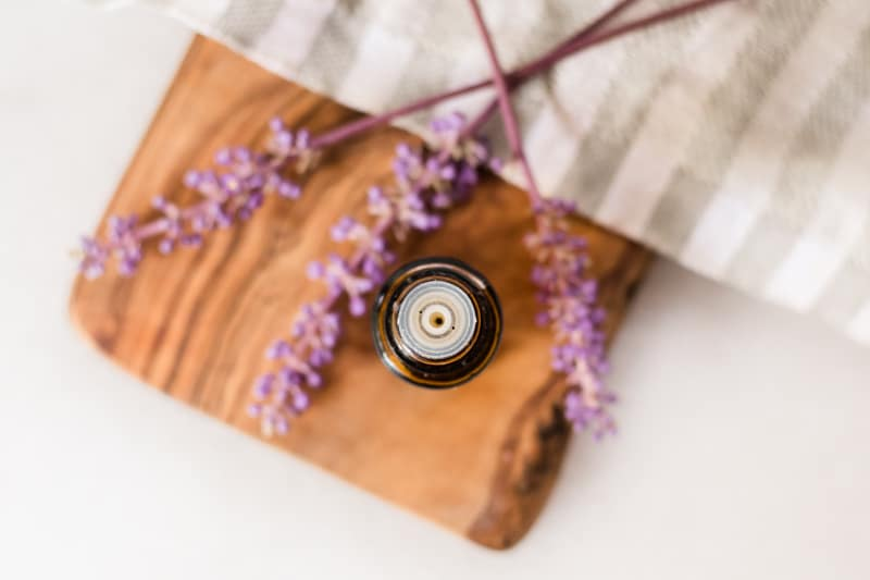Lavender essential oil in amber colored bottle with dropper top.