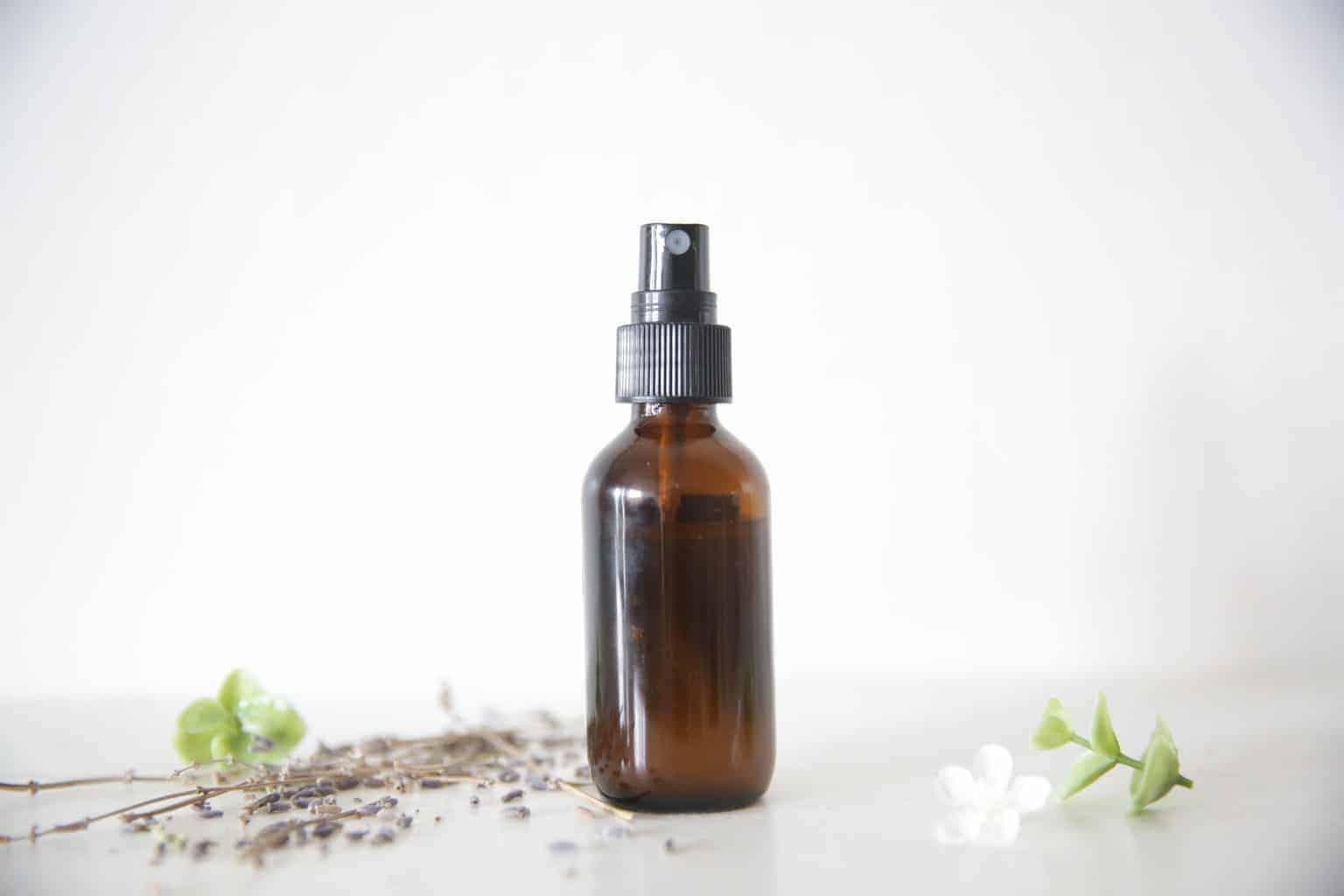 homemade poison ivy spray in glass bottle