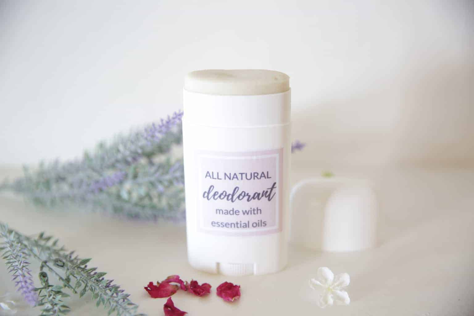 All natural deodorant with essential oils surrounded by lavender sprigs and rose petals