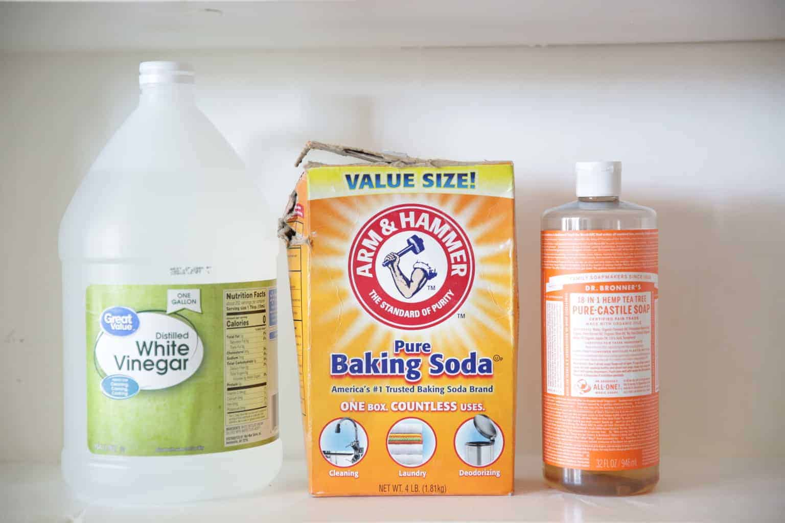 containers of white vinegar, baking soda and Castile soap