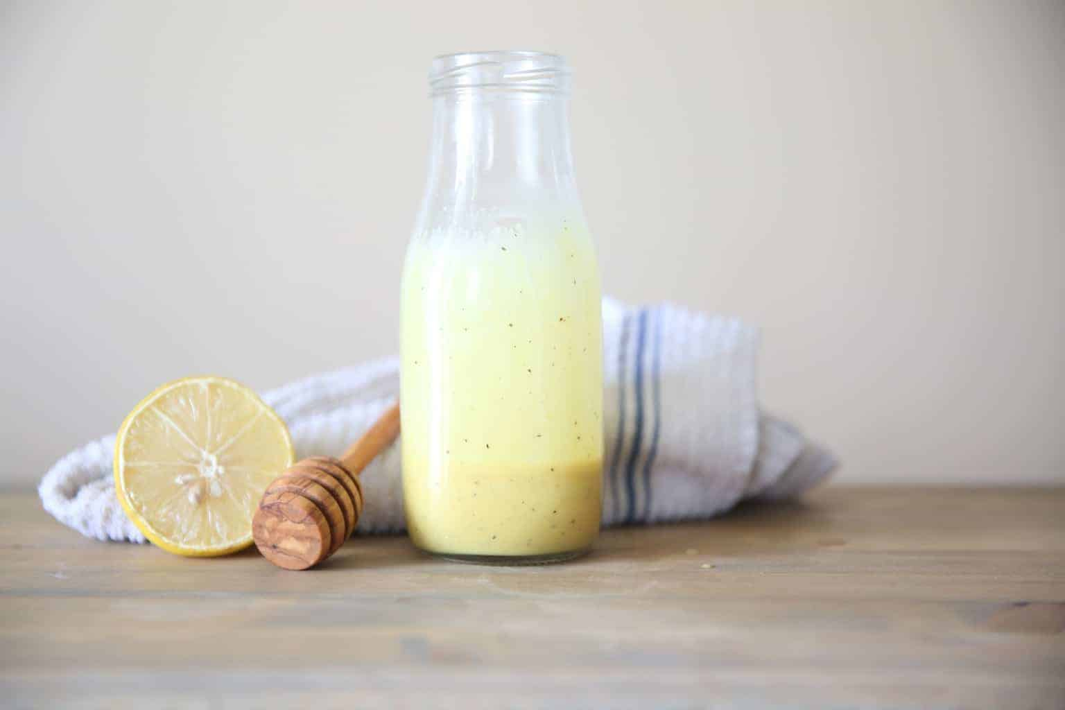 lemon honey mustard dressing in glass dressing jar