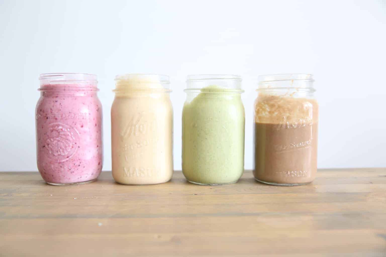 4 healthy smoothies in small glass jars