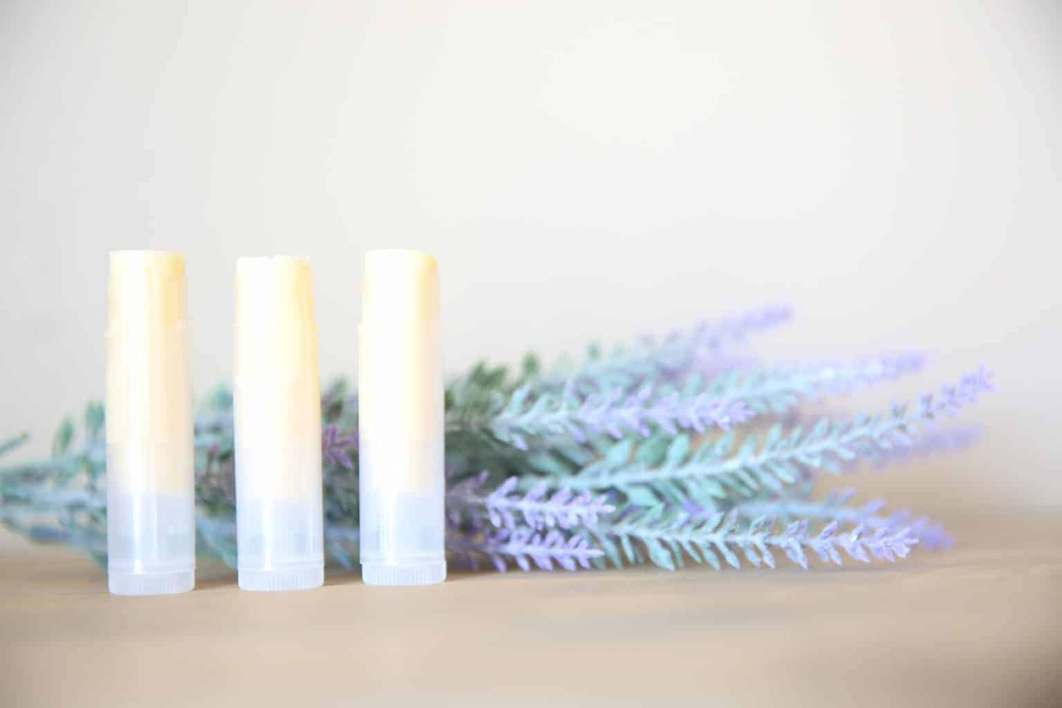 lip balm in clear tubes and lavender sprigs