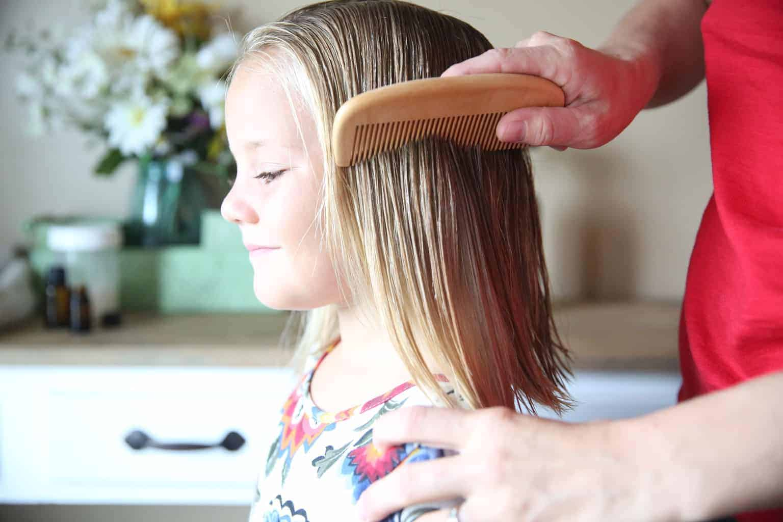 combing out hair after spraying with diy hair detangler spray