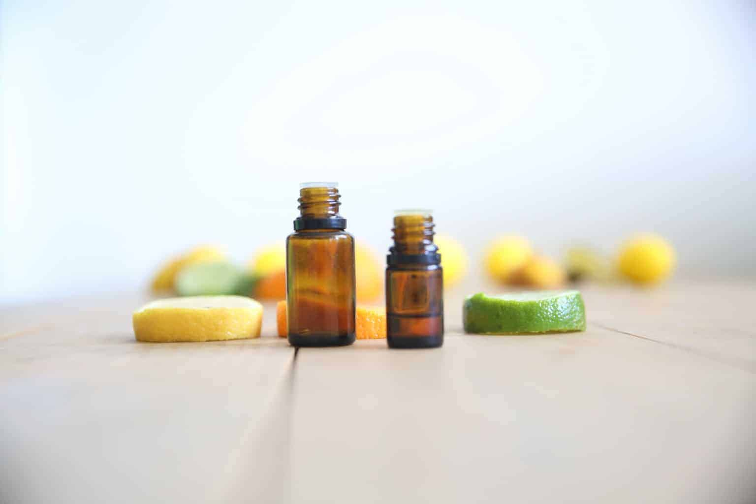 citrus essential oil bottles with sliced lemon and lime