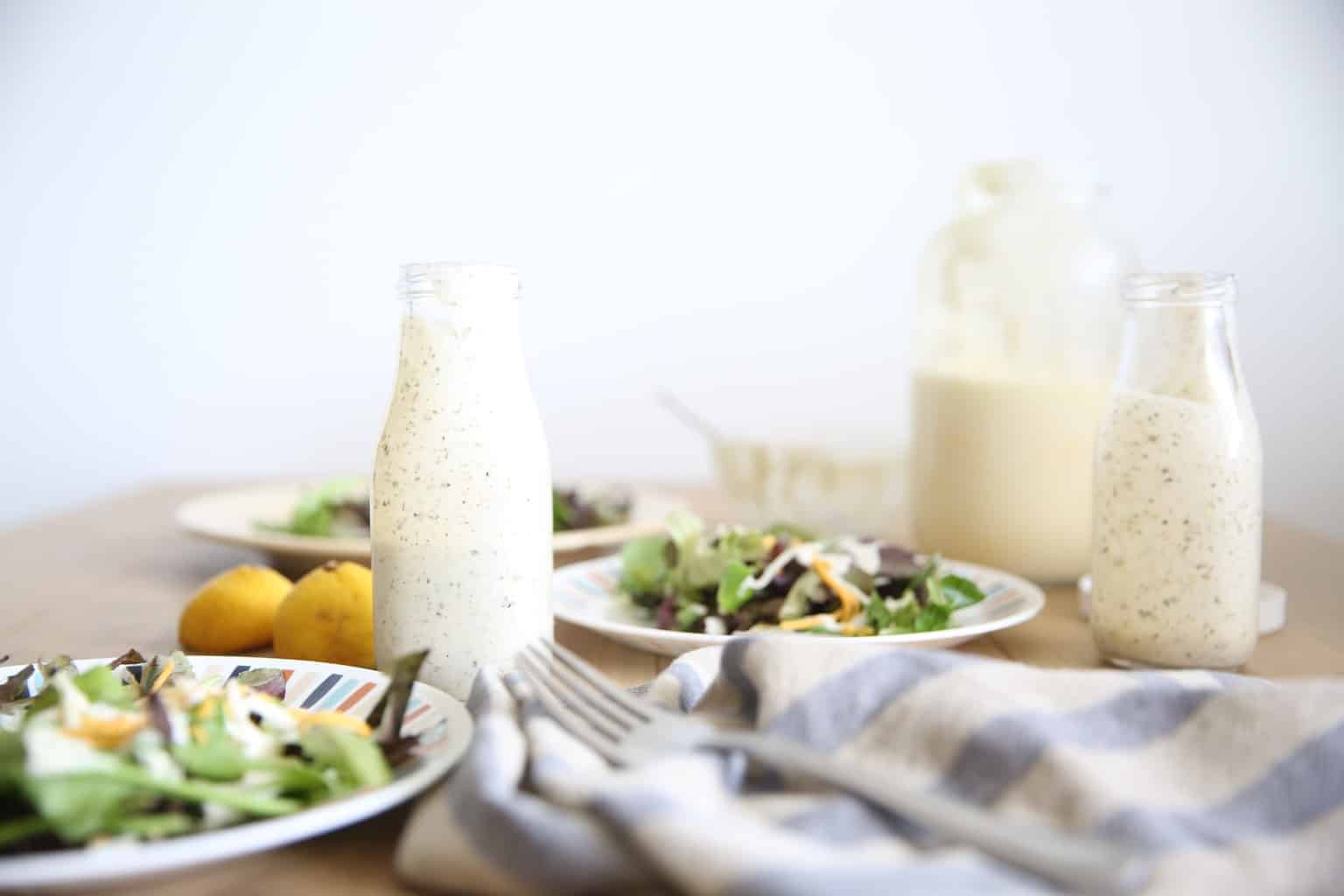 table set with salads and greek yogurt ranch dressing
