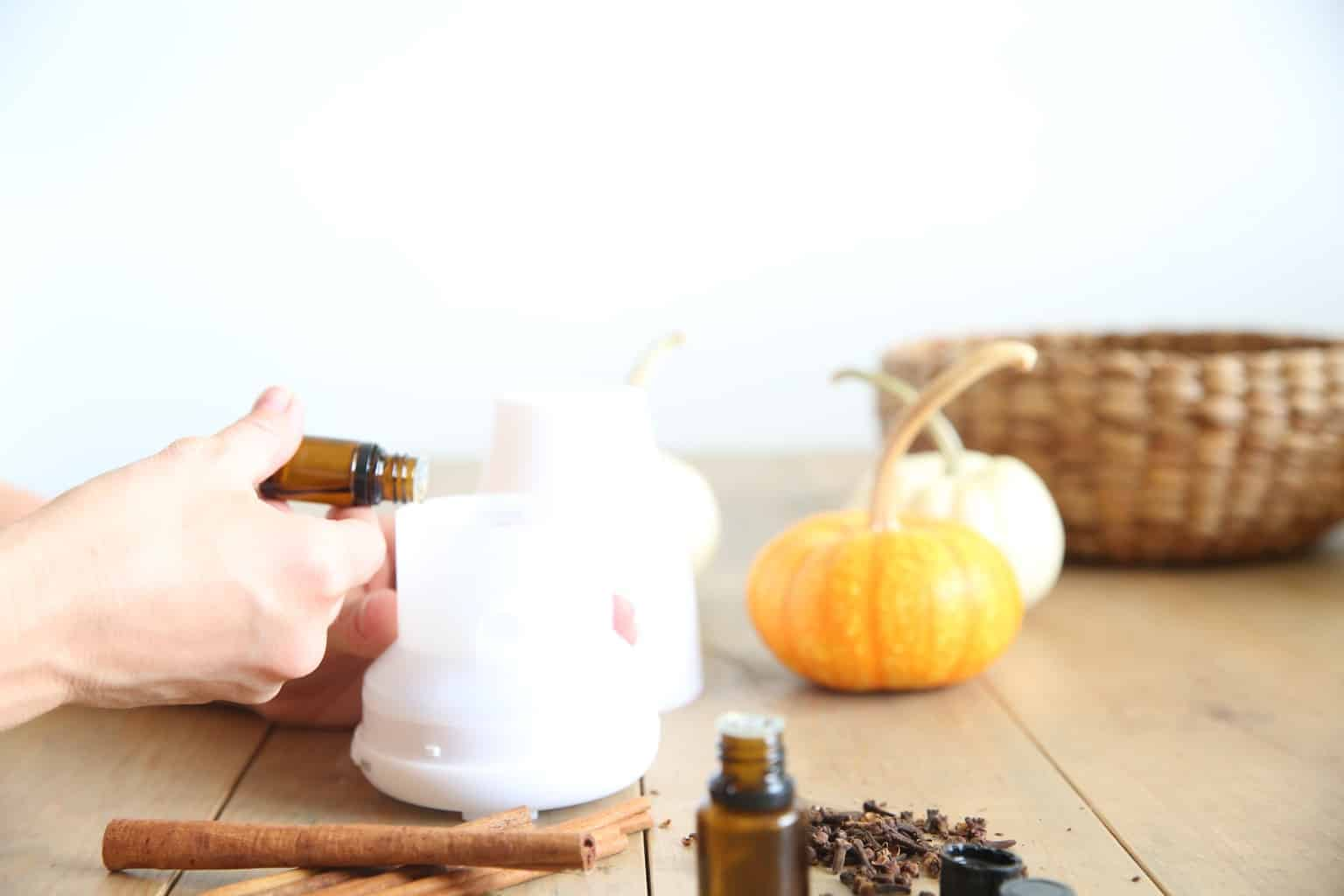 adding fall essential oils to a diffuser