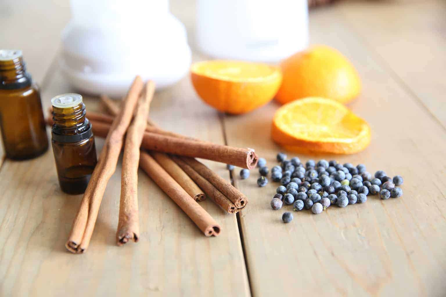 dried cinnamon and orange with november essential oils