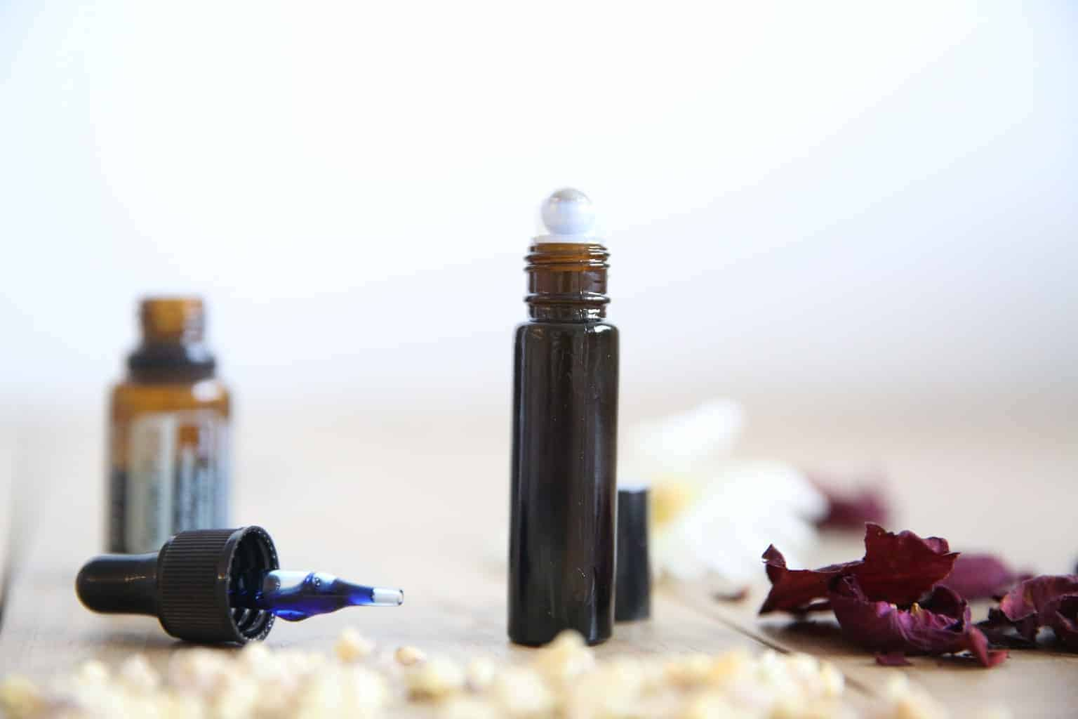 Rollerball blend for scars with essential oil dropper bottle and top.