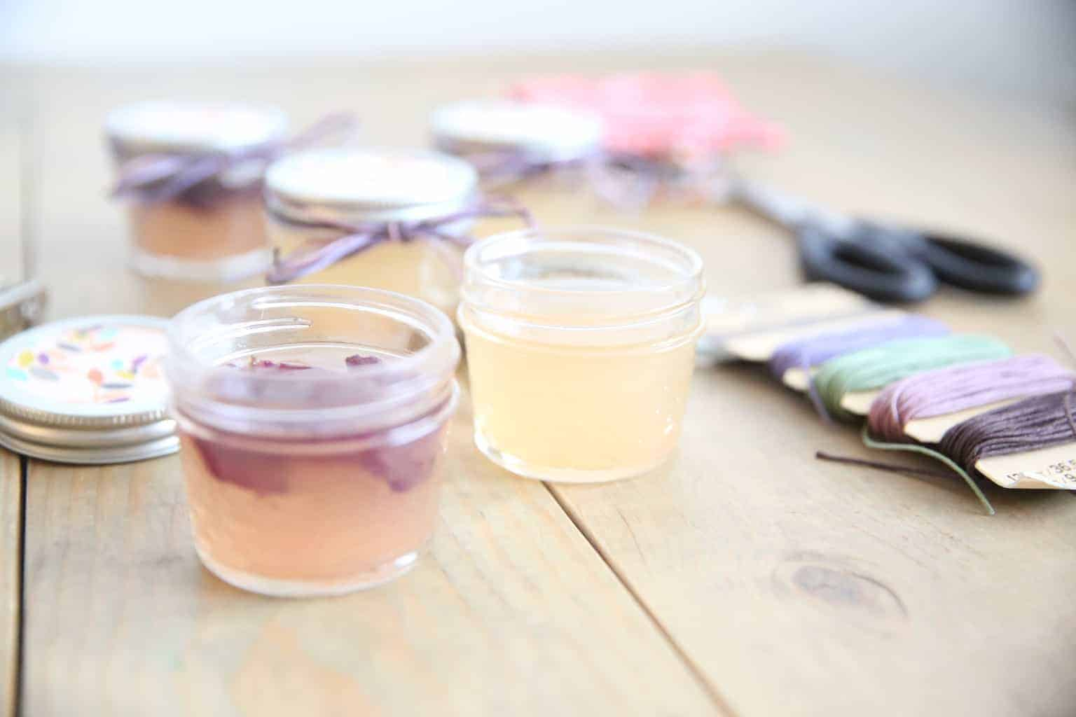 Homemade air fresheners in shallow glass jars.