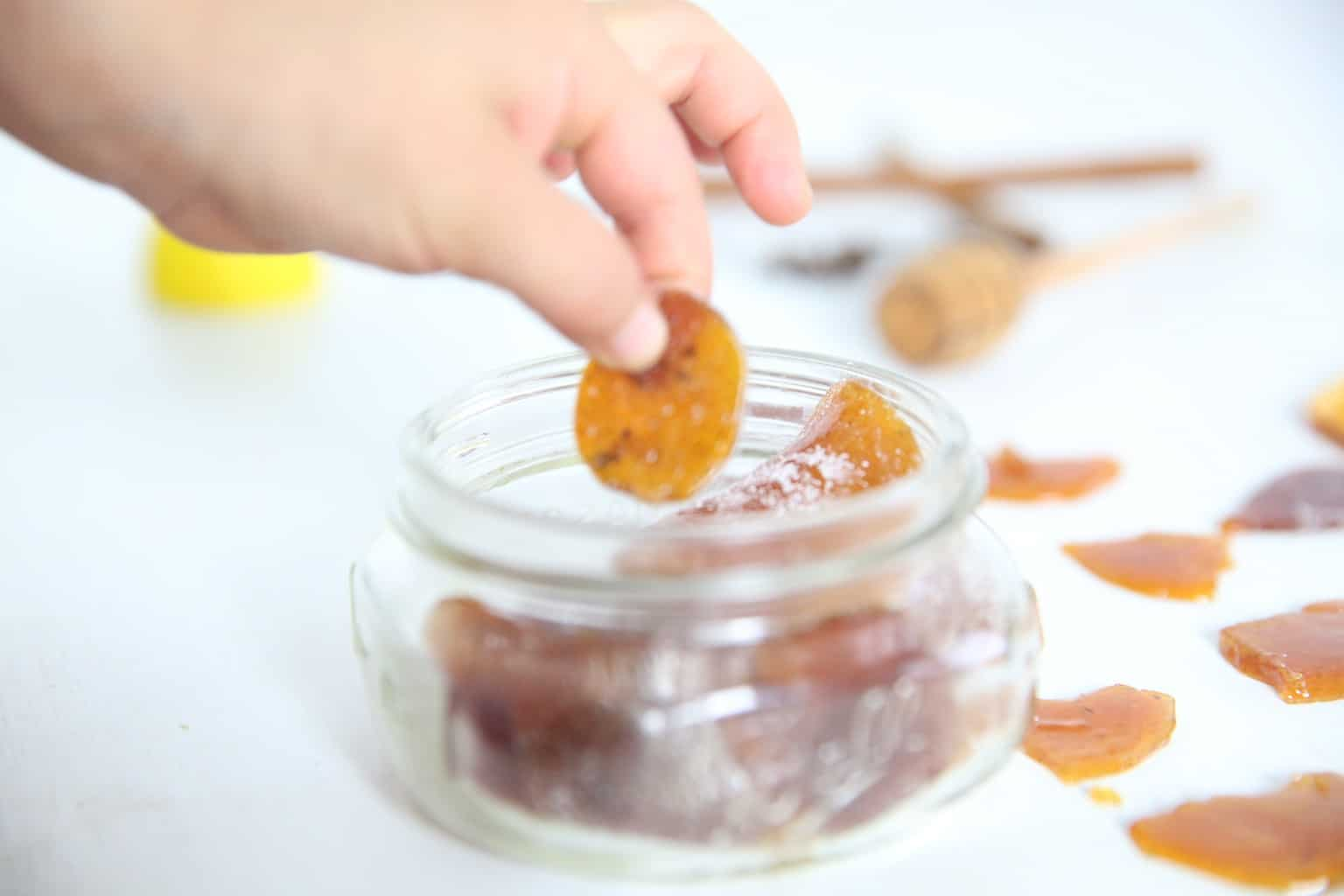 Removing cough drop from small mason jar.