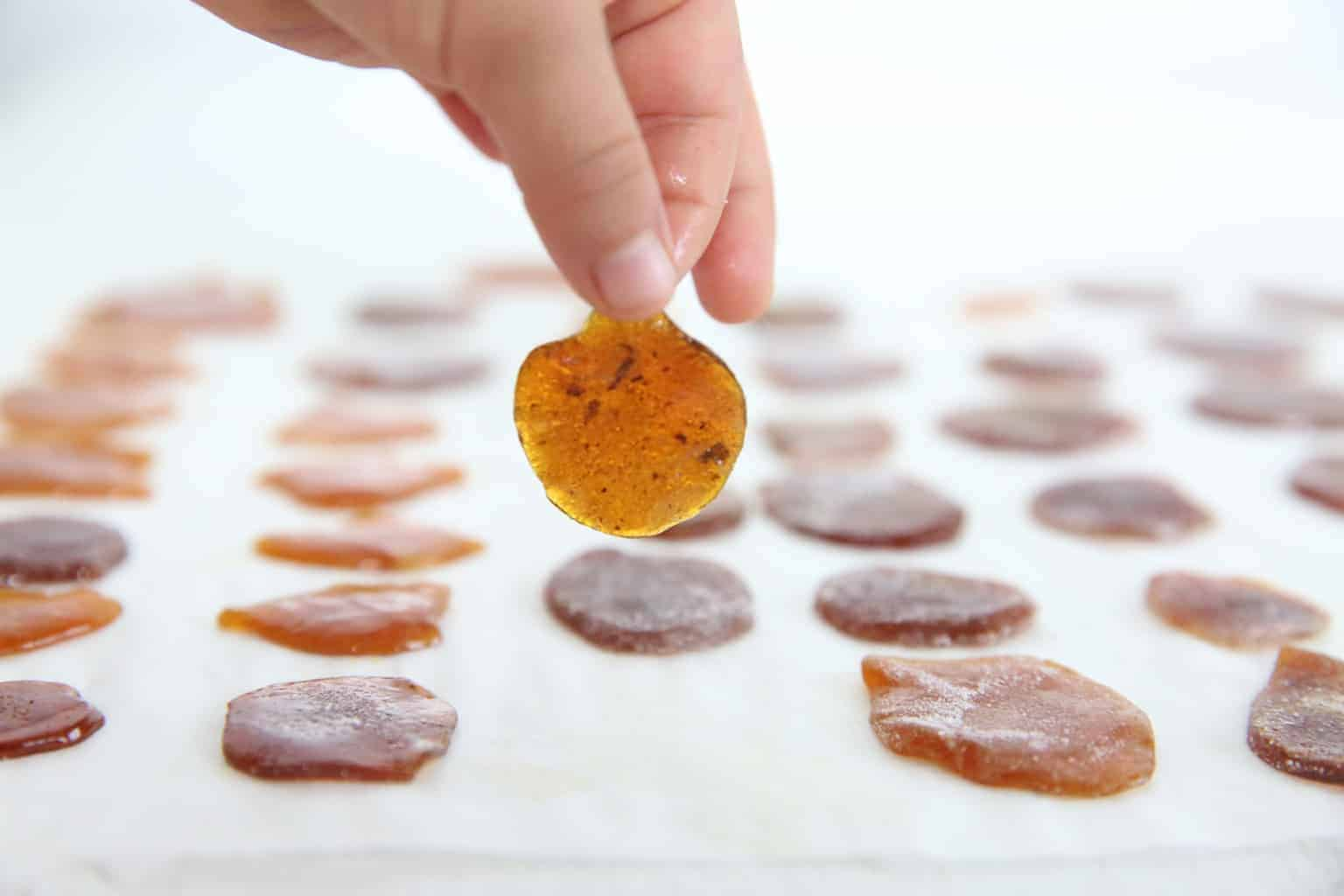 Homemade cough drops on parchment paper.