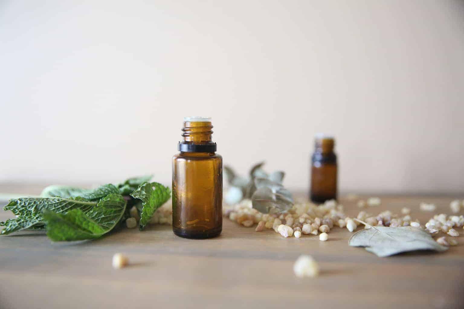 Myrrh oil bottles on wooden table.