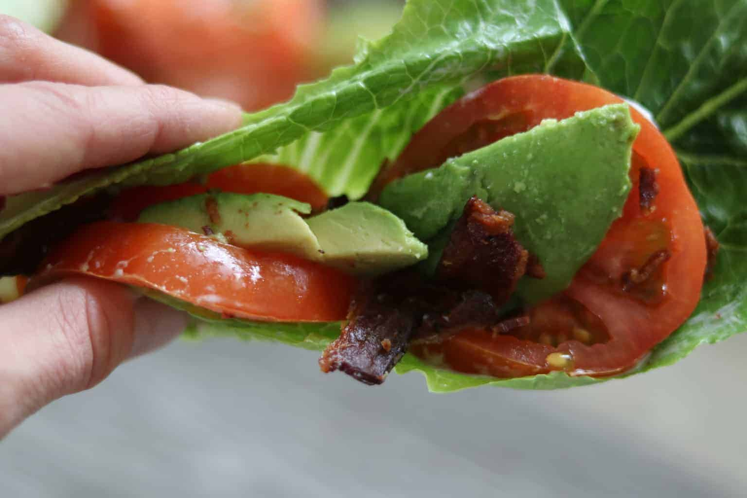 Tomatoes, avocado, and bacon rapped in lettuces.