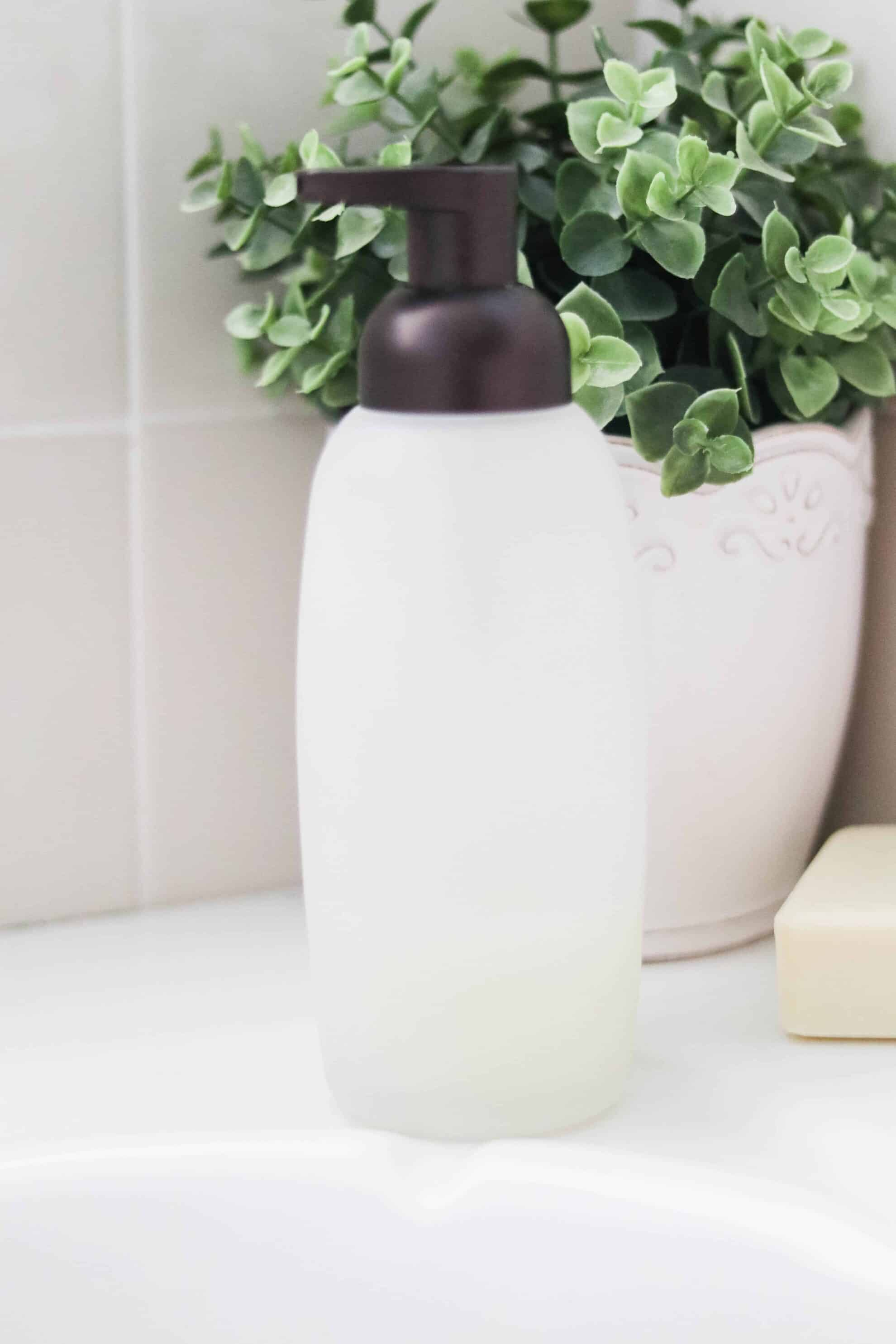 foaming hand soap dispenser on white bath tub
