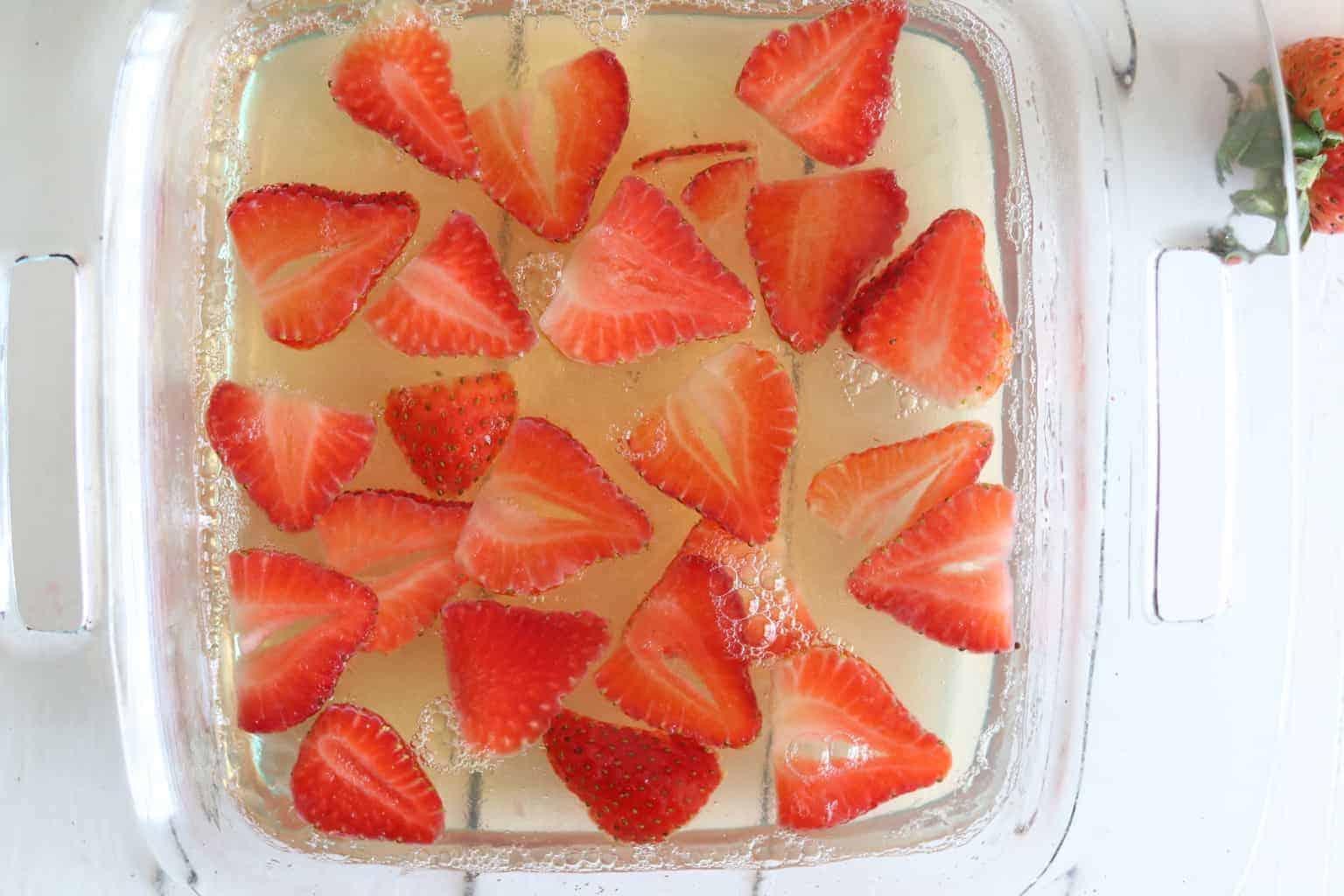 Healthy homemade strawberry jello in baking pan.