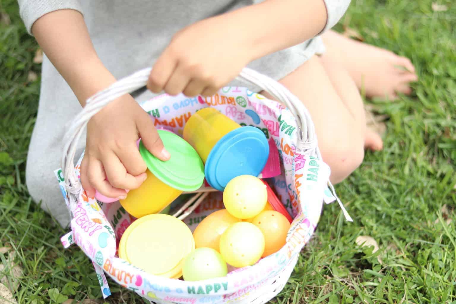Little girl holding Easter basket.