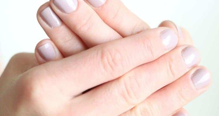 Learn how to make an essential oil roller bottle for long, strong, and healthy nails.