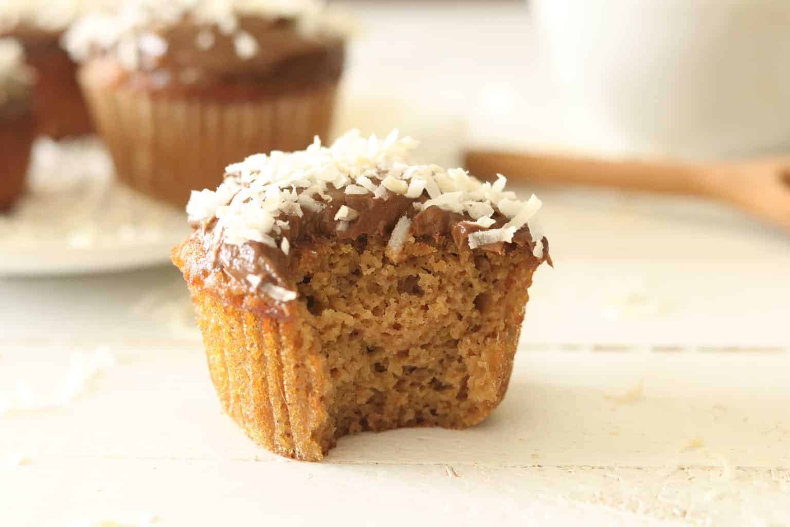 Vanilla cupcake with chocolate frosting topped with coconut.