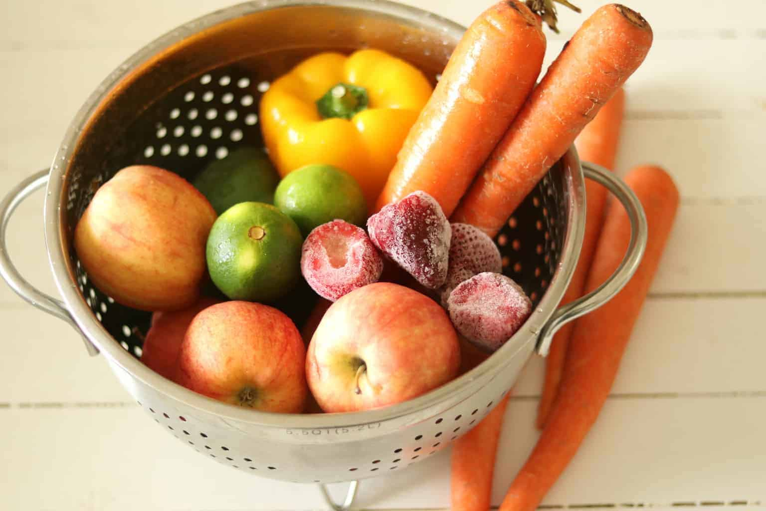 Fruit and vegetables in a strainer.