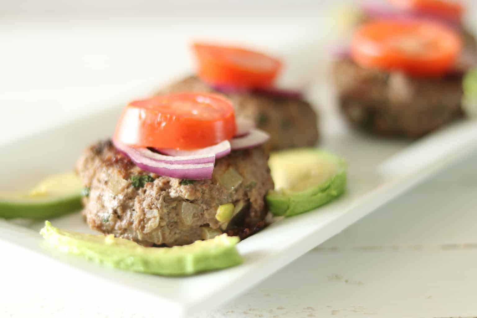 burgers with tomatoes and avocados