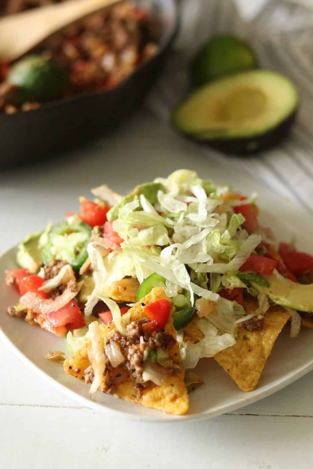 Paleo nachos topped with lettuce
