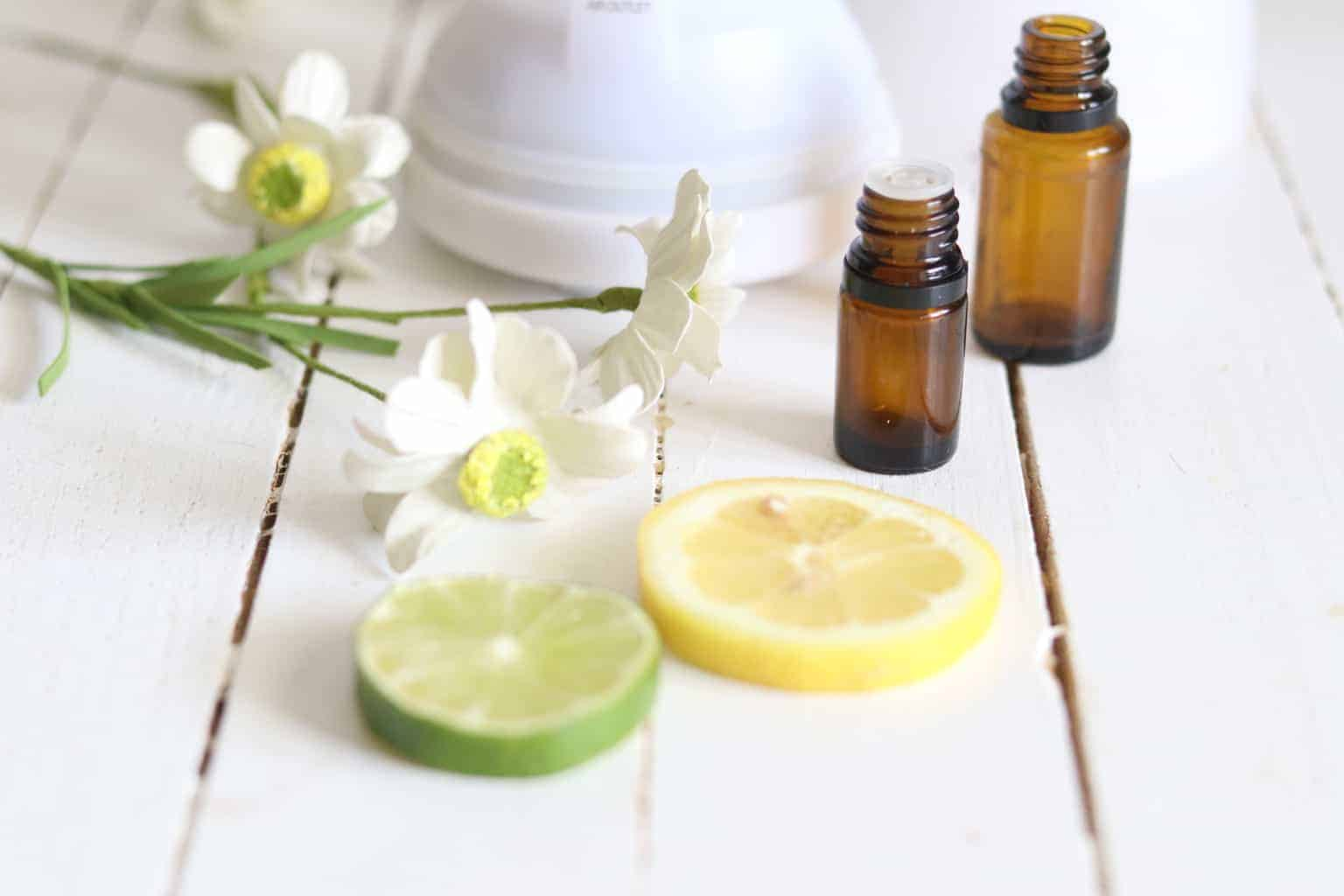 essential oil bottles and citrus fruit