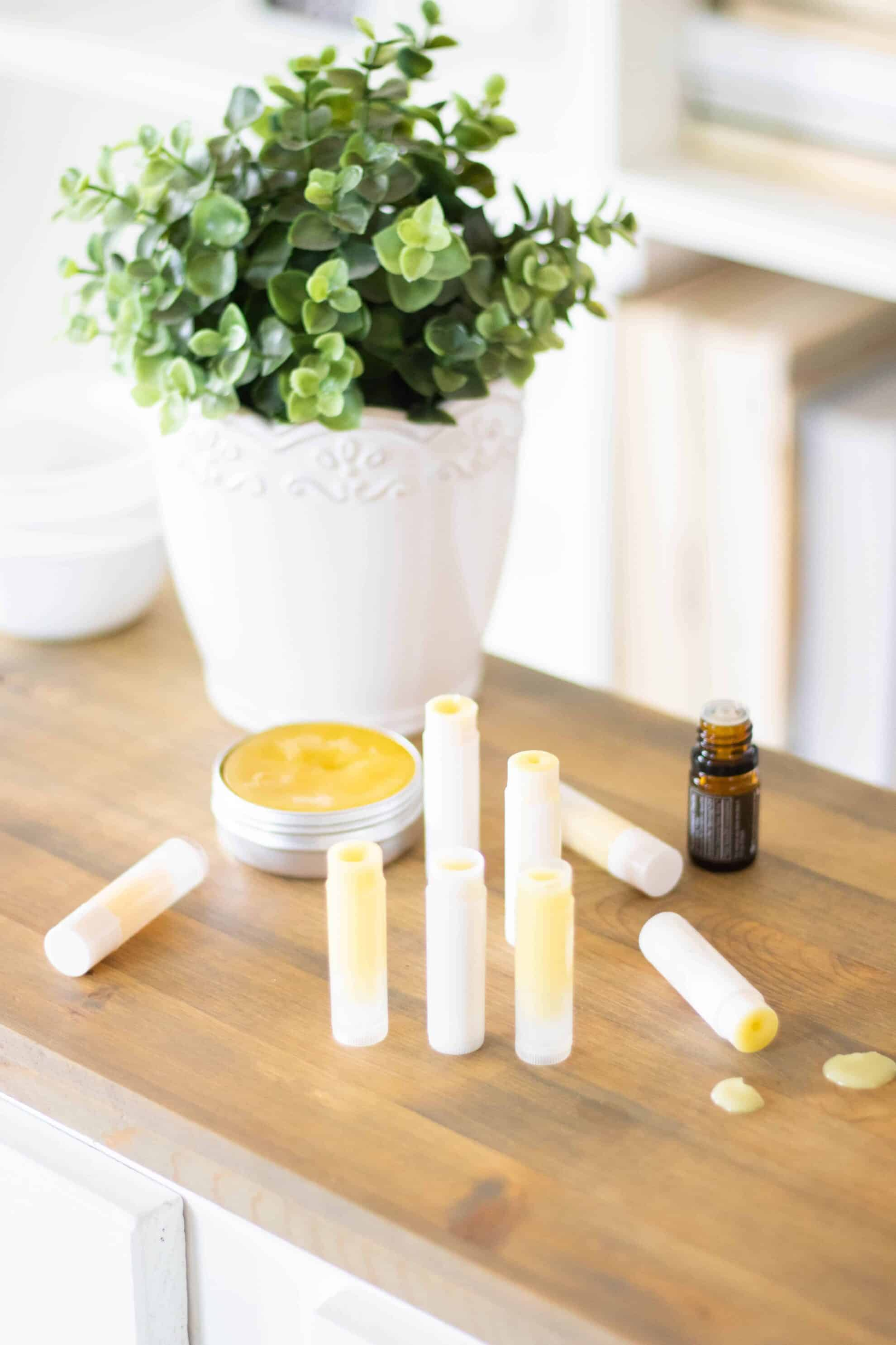 Anti itch cream in lip balm tubes on wooden table.
