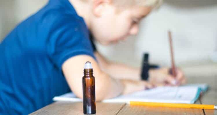 roller bottle by little boy writing letters