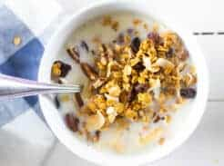 granola cereal and milk in white bowl