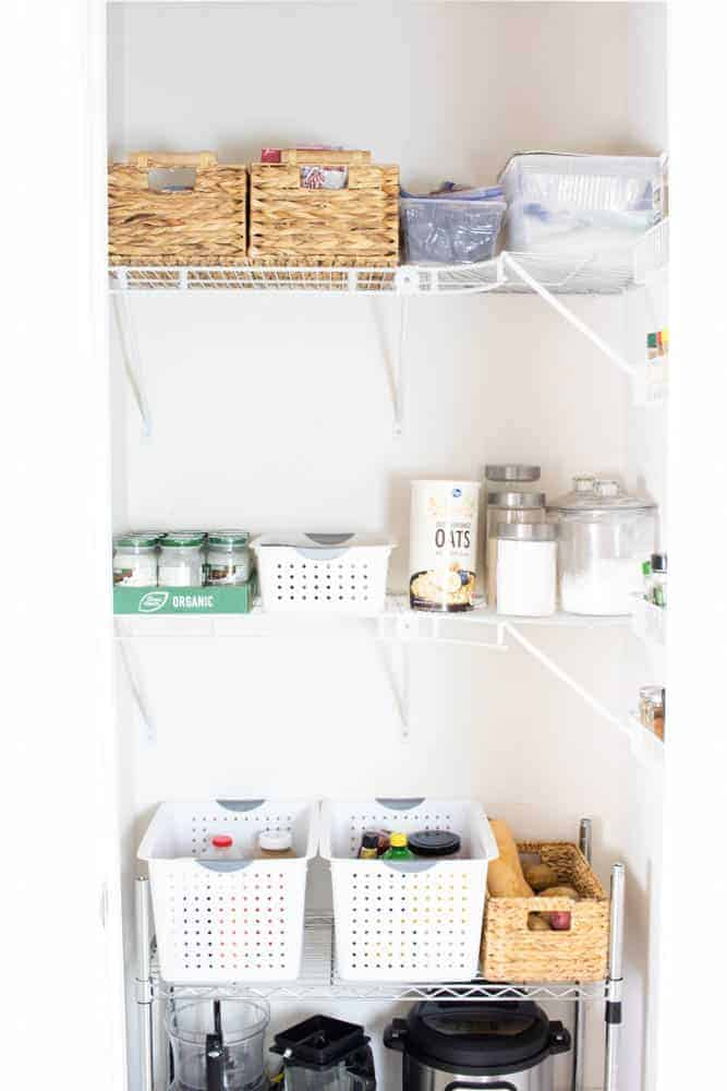 Clutter free pantry with storage containers on shelves.