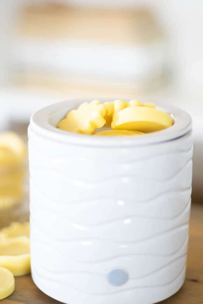 beeswax wax melt in white candle warmer