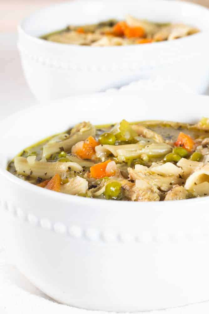 healthy turkey noodle soup in white bowl