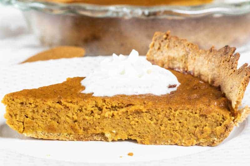 slice of homemade pumpkin pie with gluten free crust