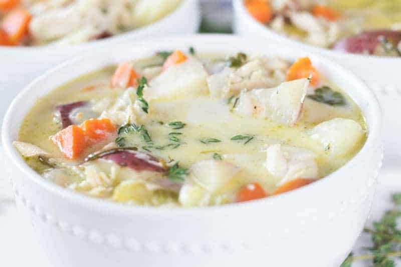 whole 30 creamy chicken soup in white bowl