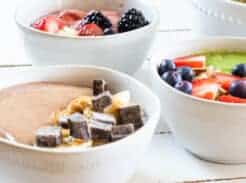 smoothie bowls with toppings in white bowls