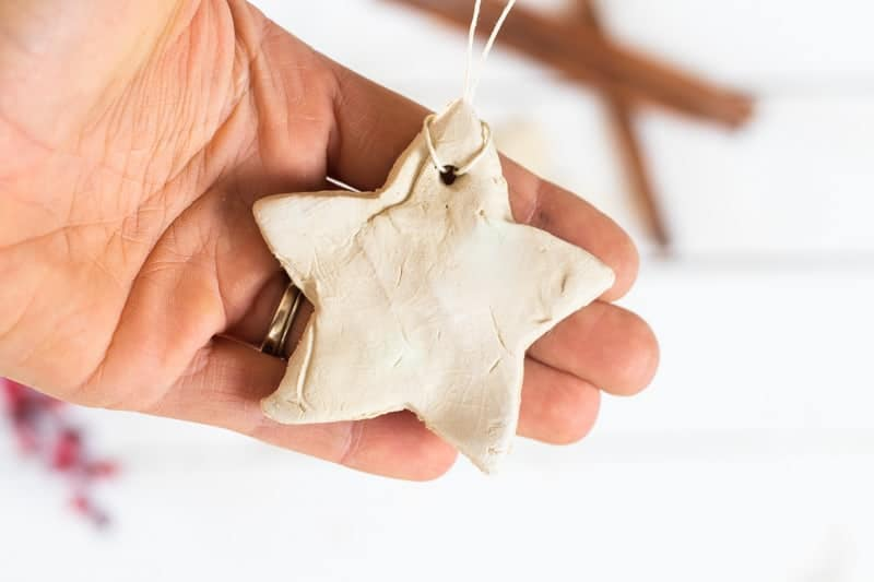 holding a homemade essential oil diffuser ornament white star shaped