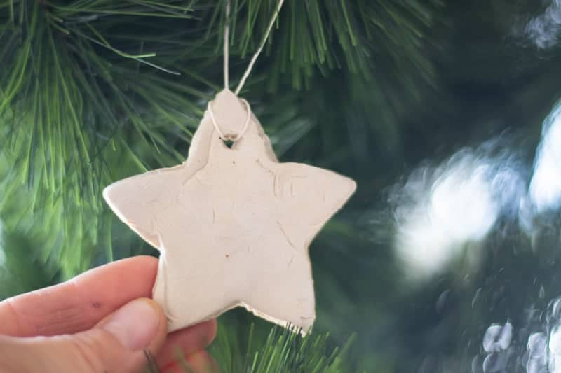 hanging white star ornament on the Christmas tree
