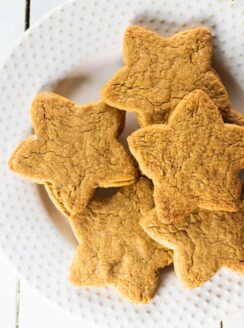 white plate of coconut sugar star shaped cookies