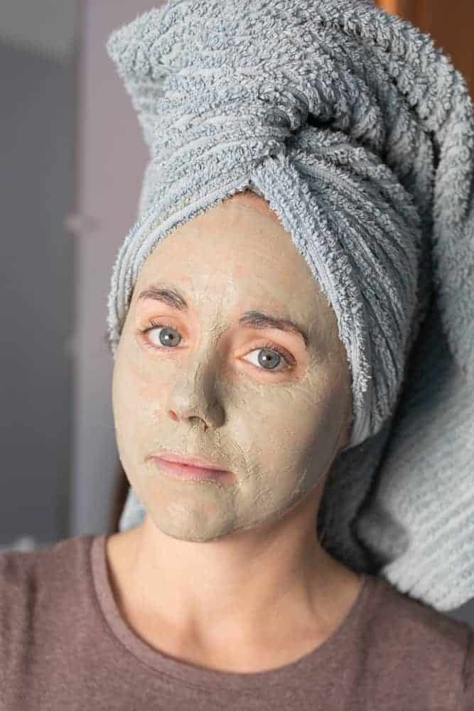 women with clay mask on her face