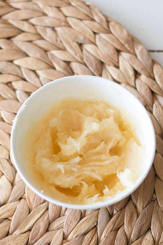coconut honey hair mask cream in white bowl on a wicker mat