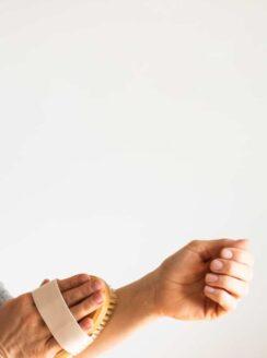 women dry brushing forearm
