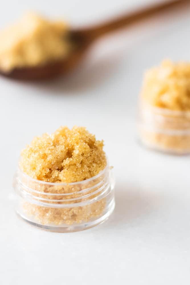 brown sugar lip scrub in small glass container