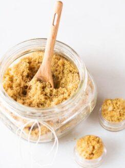 small mason jar of lip sugar scrub with wooden spoon