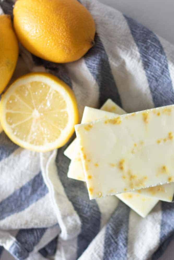 melt and pour dish soap bars with lemon slices on blue and white stripe towel