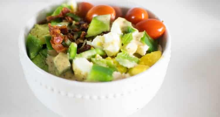healthy cobb salad in white bowl
