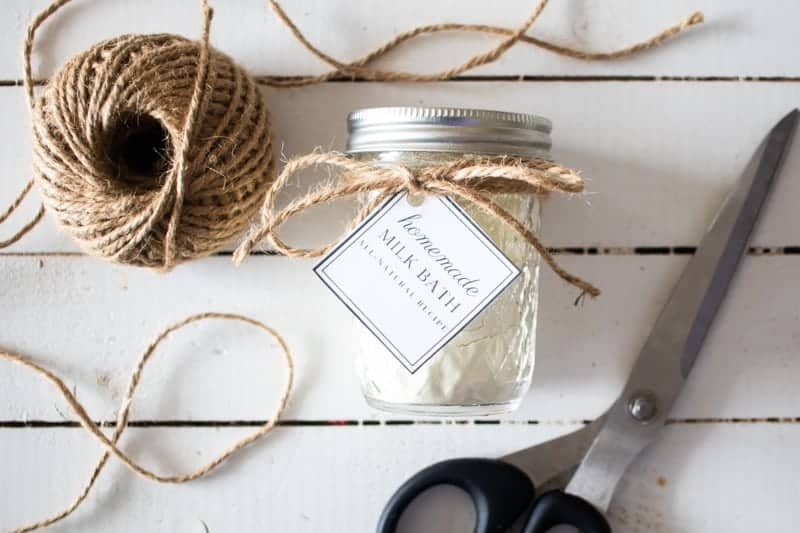 diy milk bath in mason jar with twine and label on white shiplap