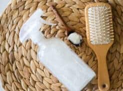 diy hair protective spray with tan brush and wooden measuring spoon