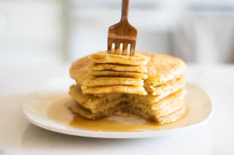 sourdough pancakes with maple syrup on white plate